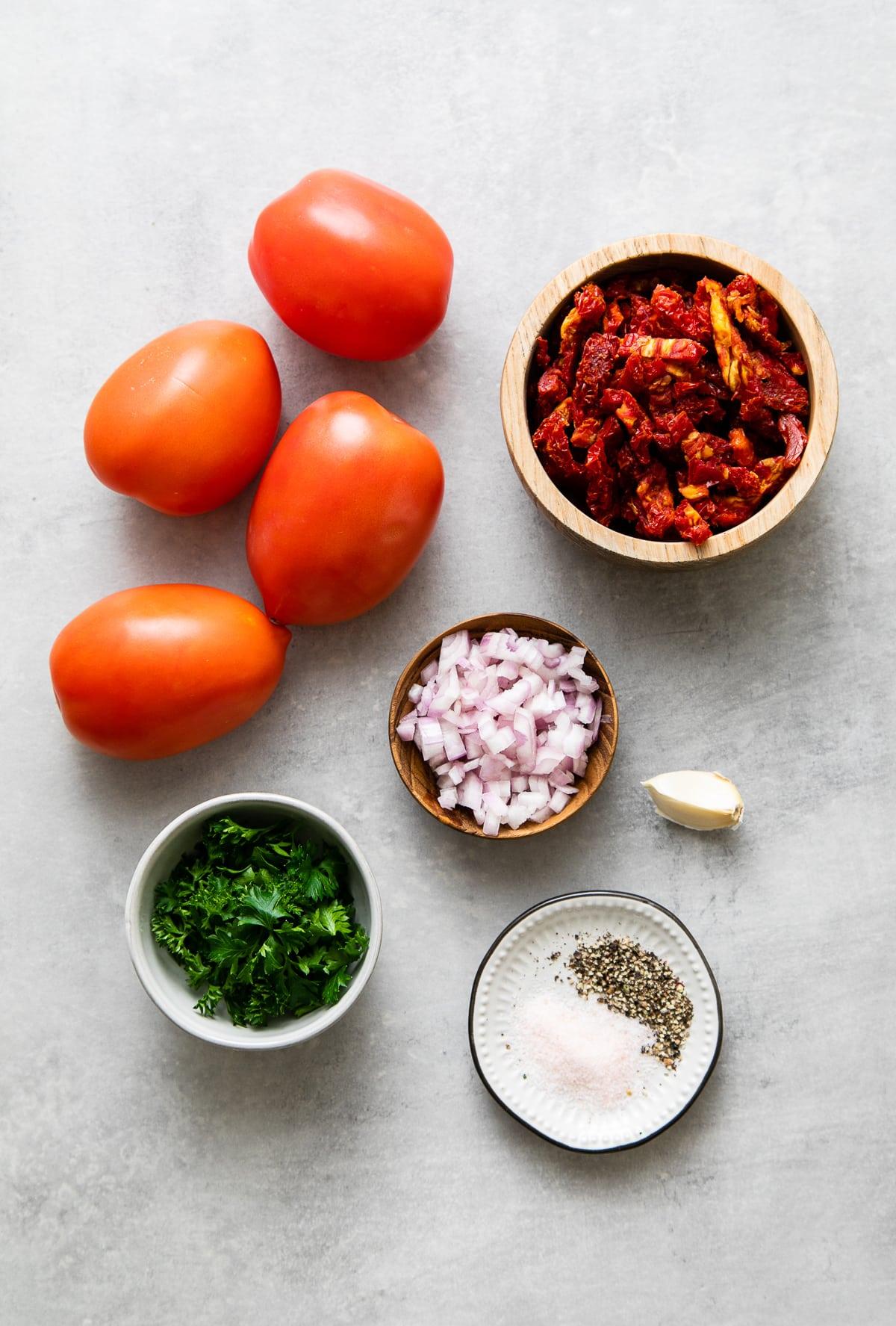 top down view of ingredients used to make raw marinara sauce recipe.