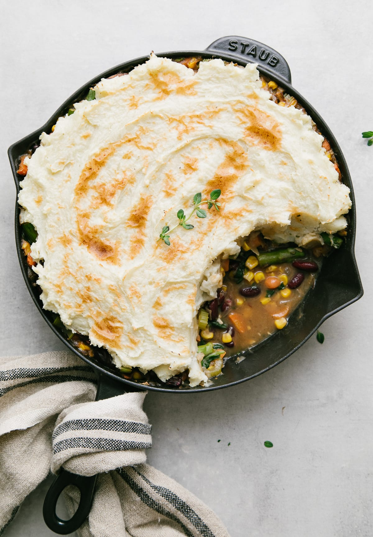 top down view of vegetarian shepherd's pie with portion removed.