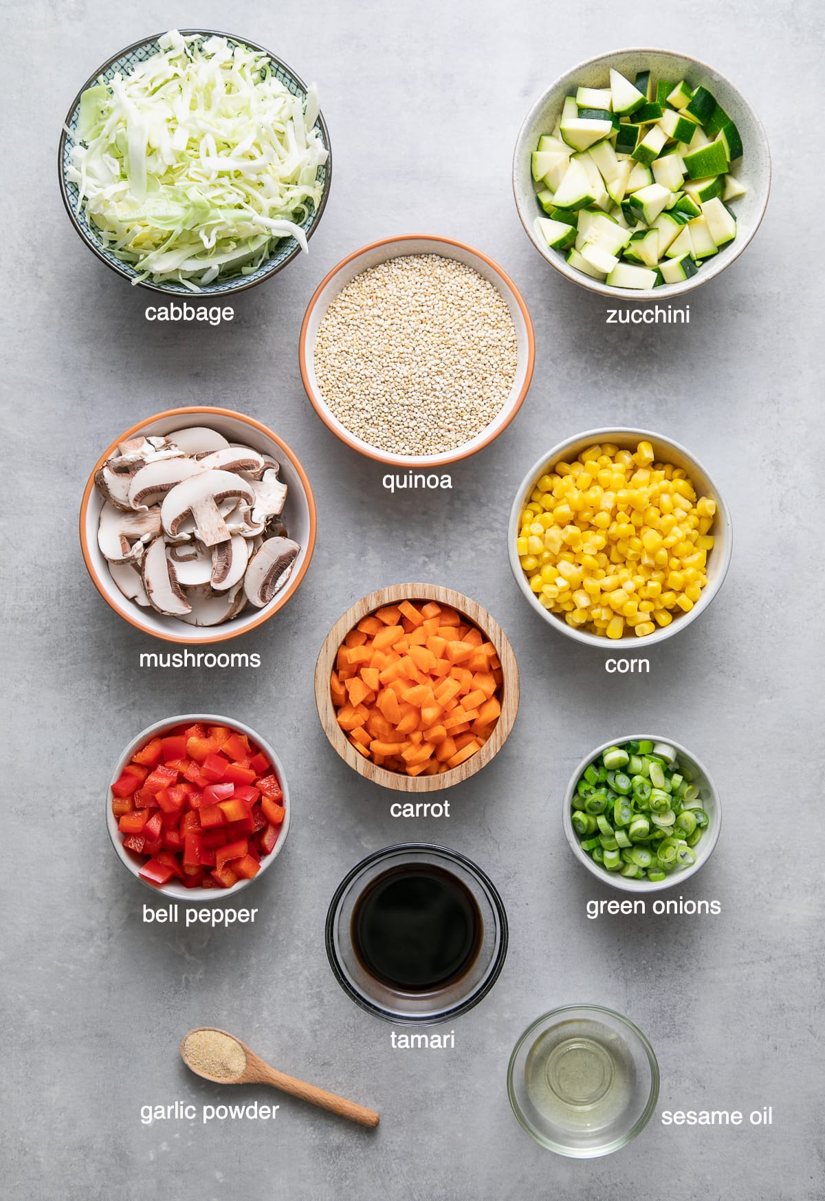top down view of ingredients used to make quinoa fried rice with vegetables.