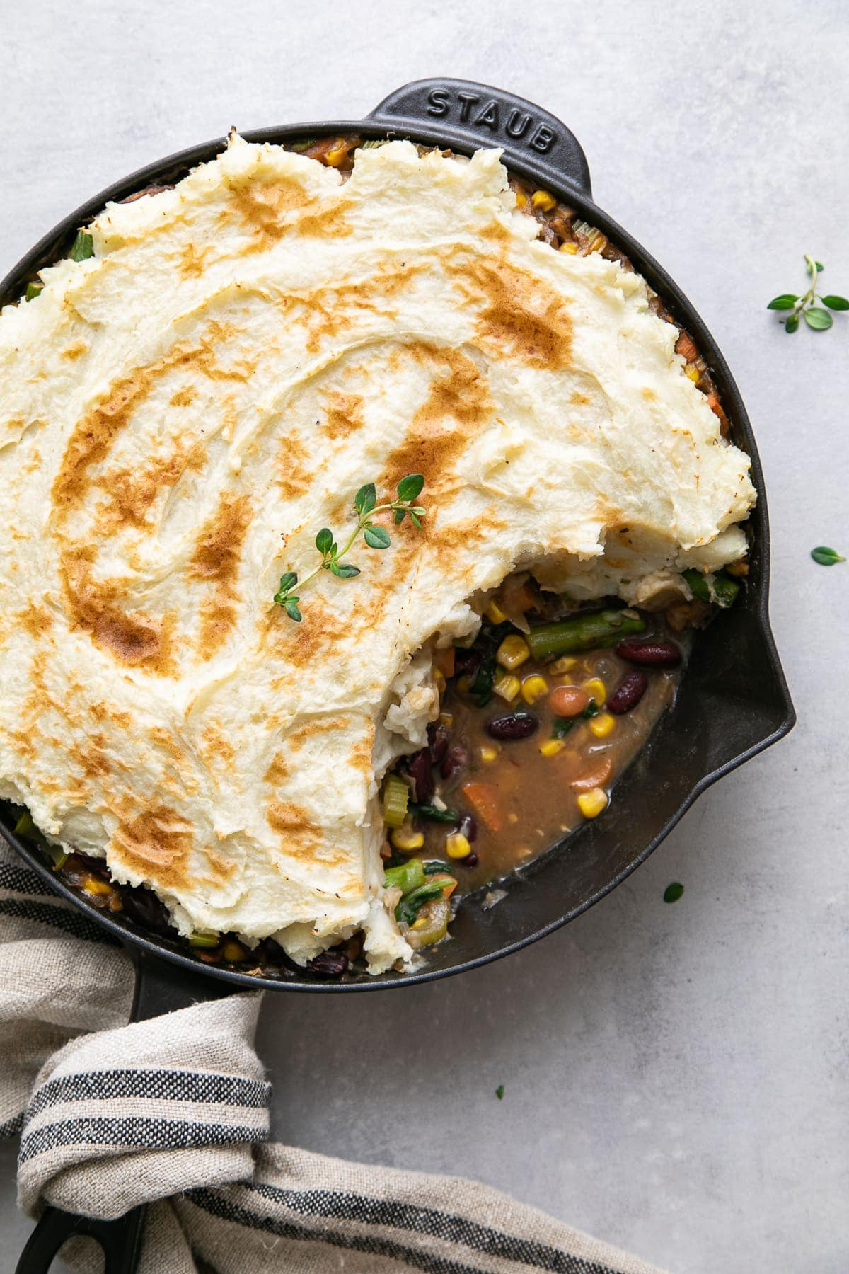 top down view of vegetarian shepherds pie with portion removed.