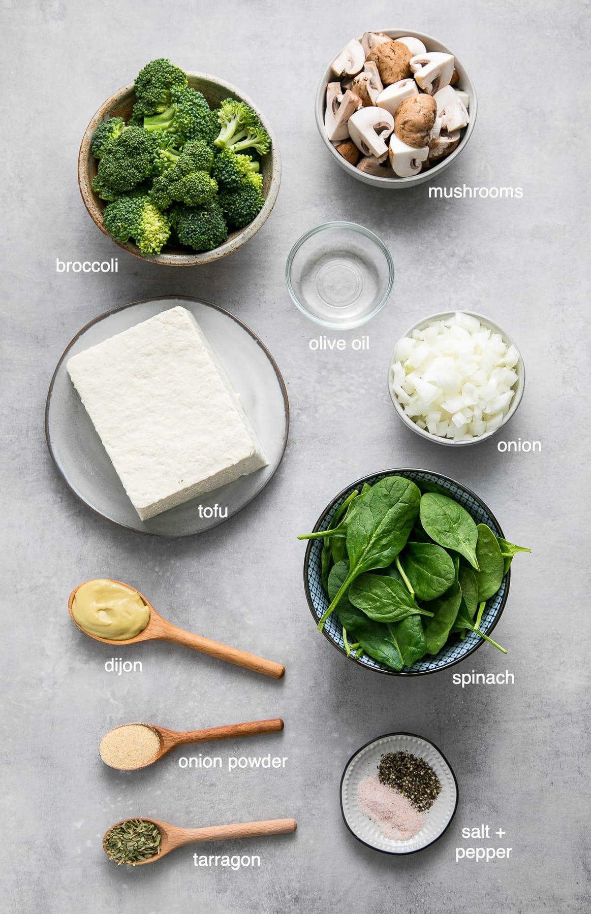 top down view of ingredients used to make vegan scrambled eggs with tofu, dijon, tarragon and veggies.