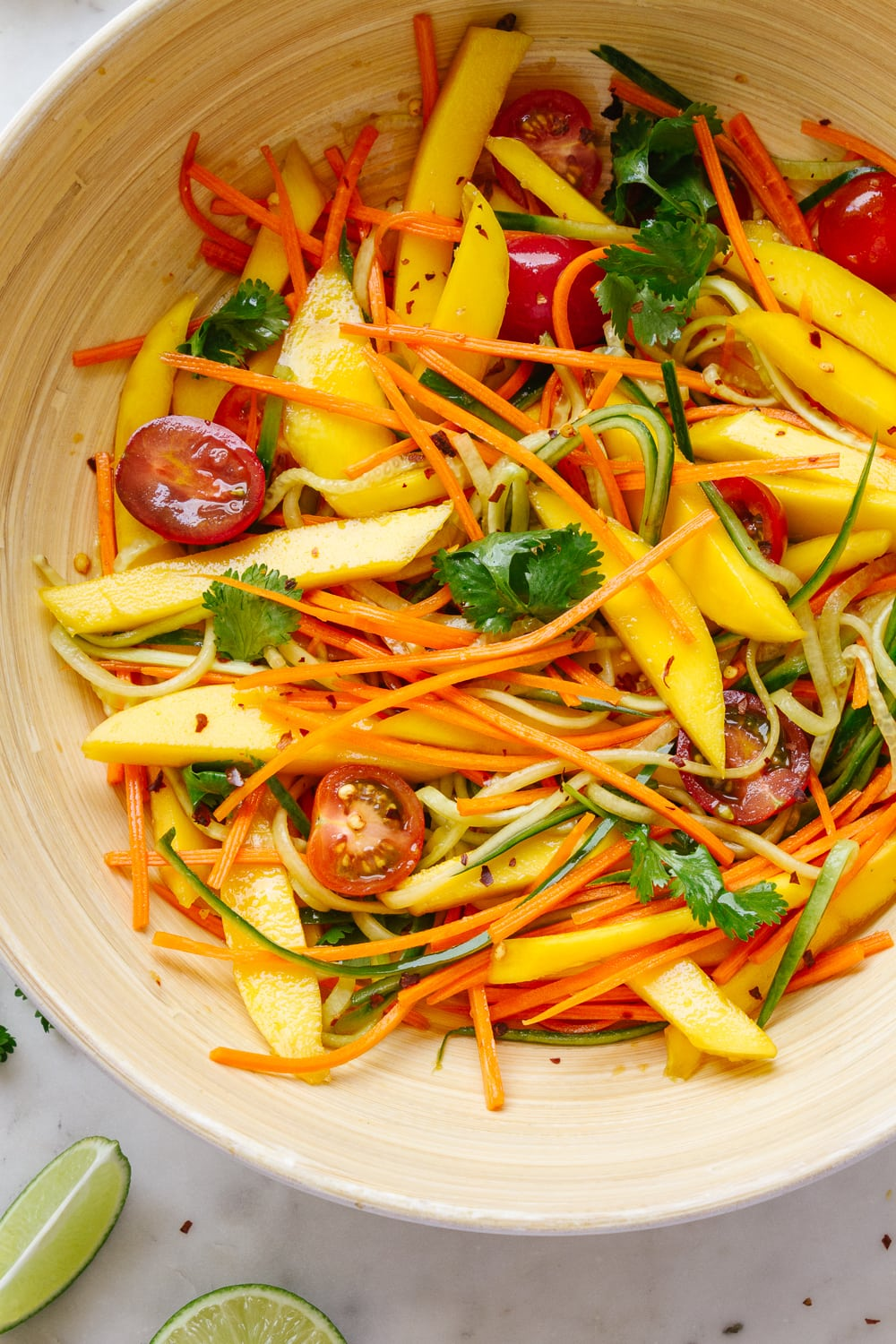 top down view of spicy mango thai salad mixed with dressing