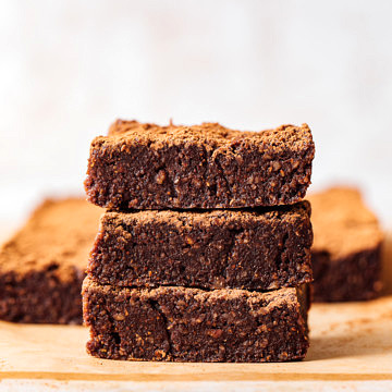 head on view of 3 stacked raw vegan brownies.