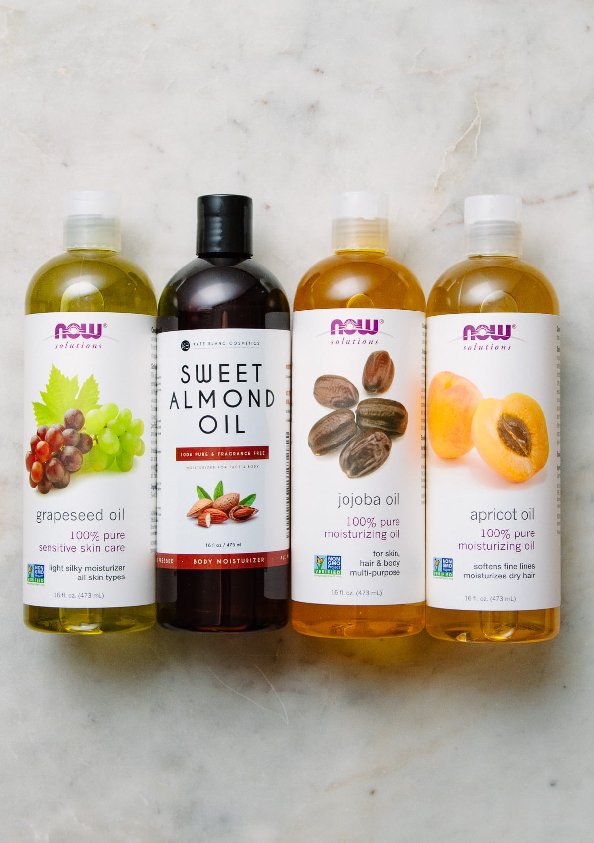 top down view of oils that can be used for diy sugar body scrubs.