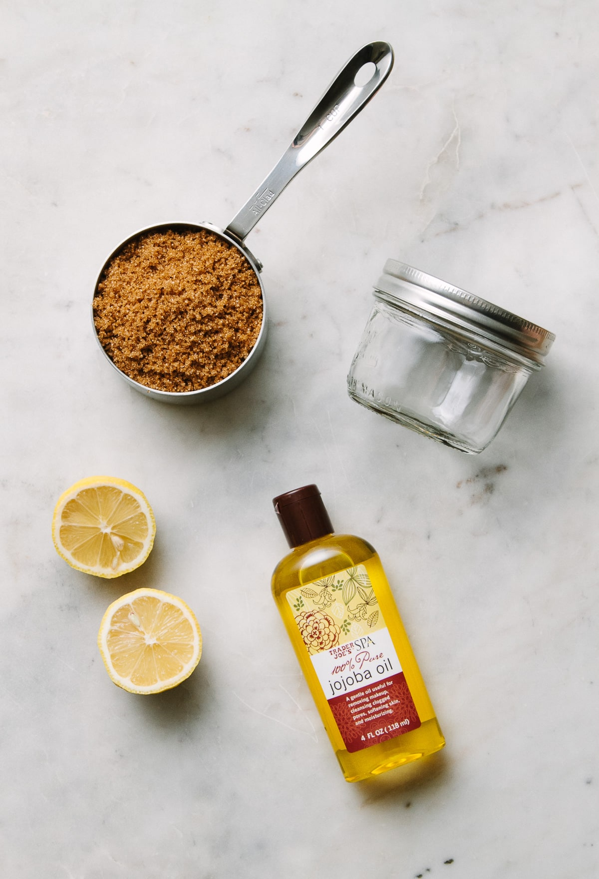 top down view of what you'll need to make edible diy body scrub. with sugar.