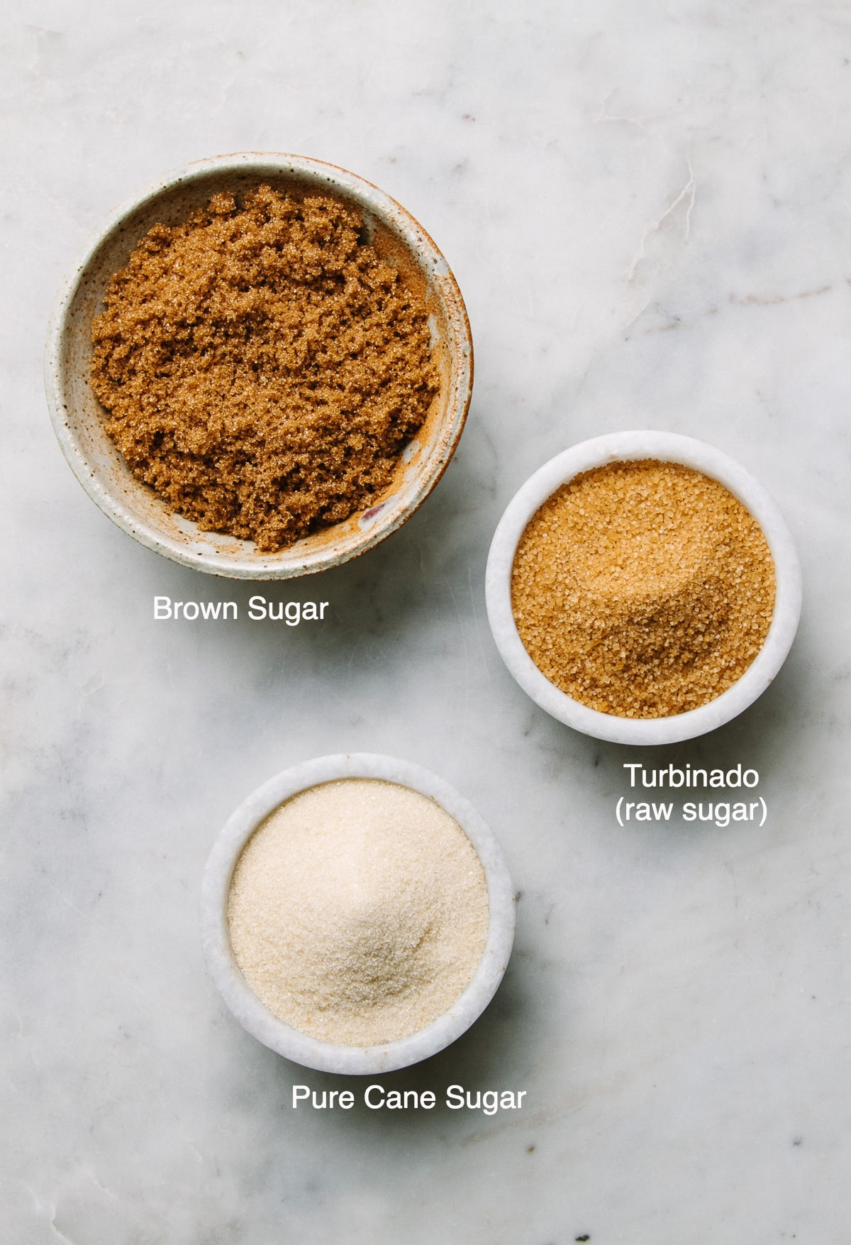 top down view of different sugars that can be used to make diy sugar body scrub.
