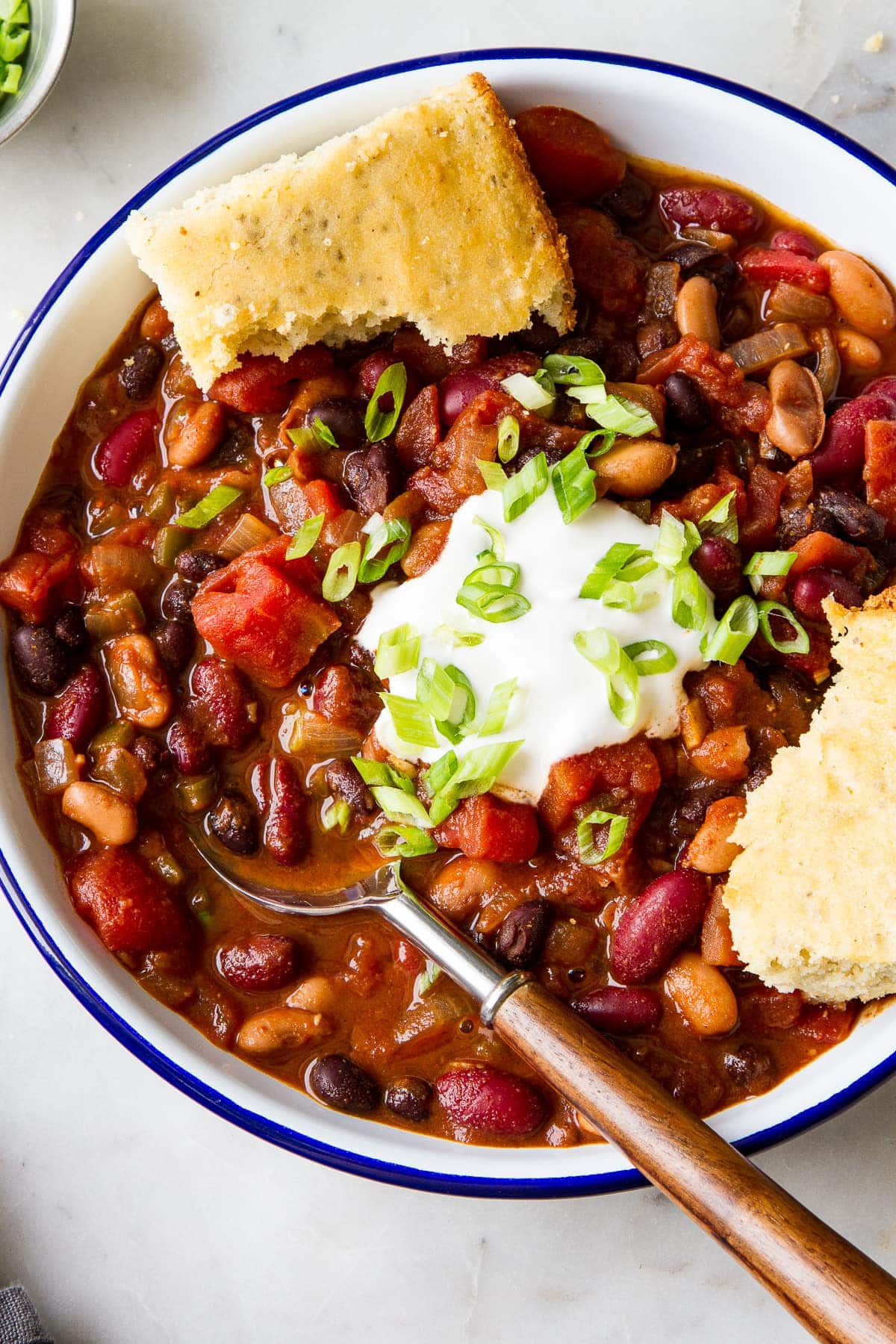 top down view of a bowl full of quick and easy three bean chili.