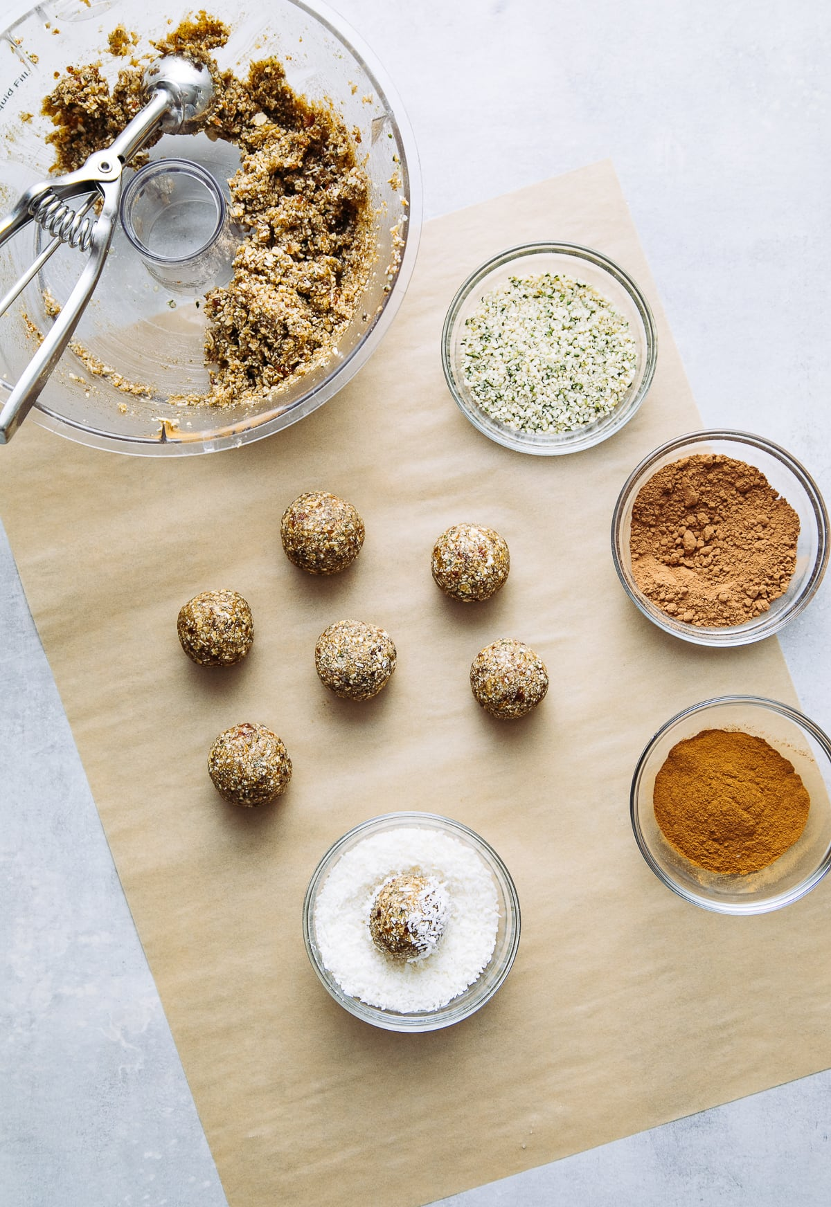 top down view showing the process of scooping and rolling energy bites dough.