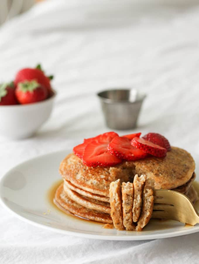 lemon chia seed pancakes with fresh strawberries and pure maple syrup