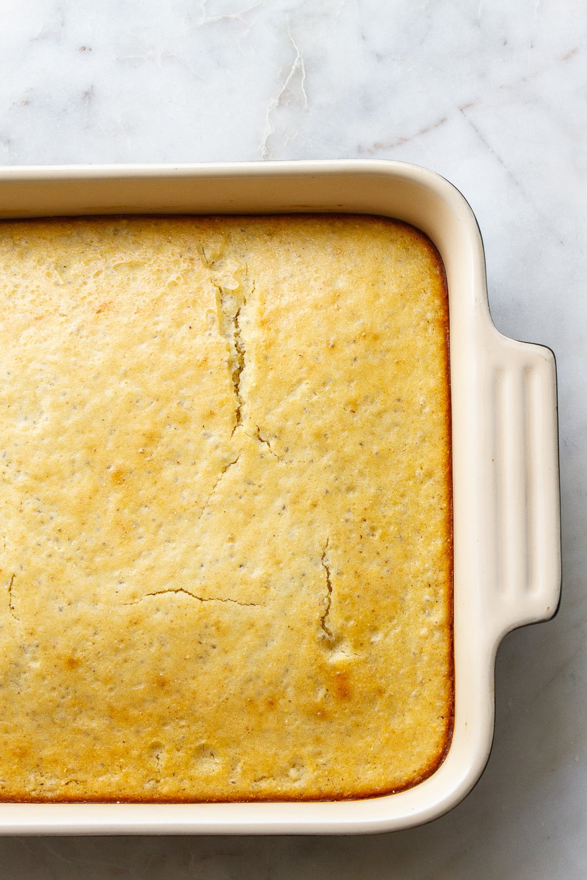 top down view of baking dish with just pulled from the oven sweet chia cornbread.