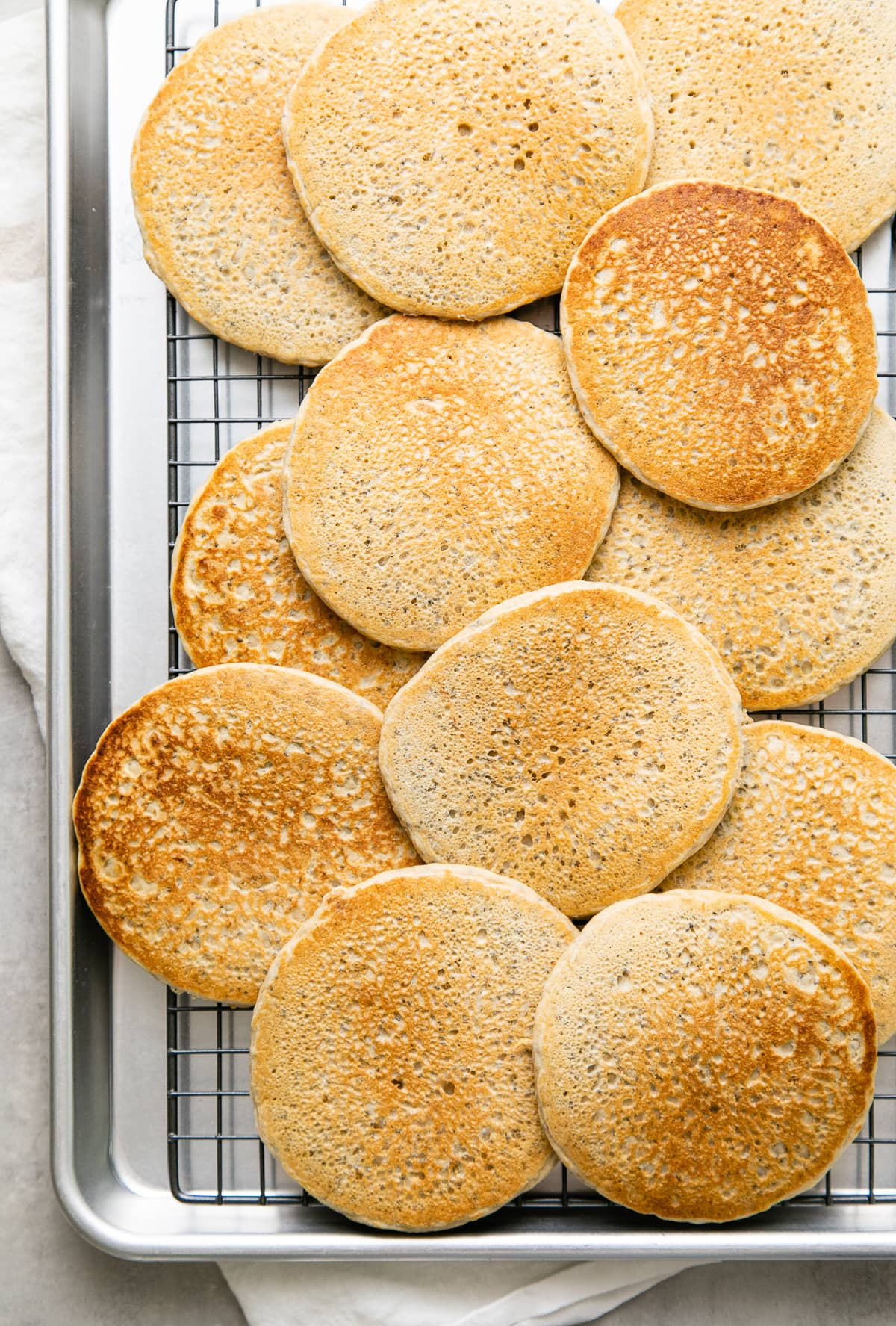top down view of lemon chia seed pancakes cooling on a wire rack.