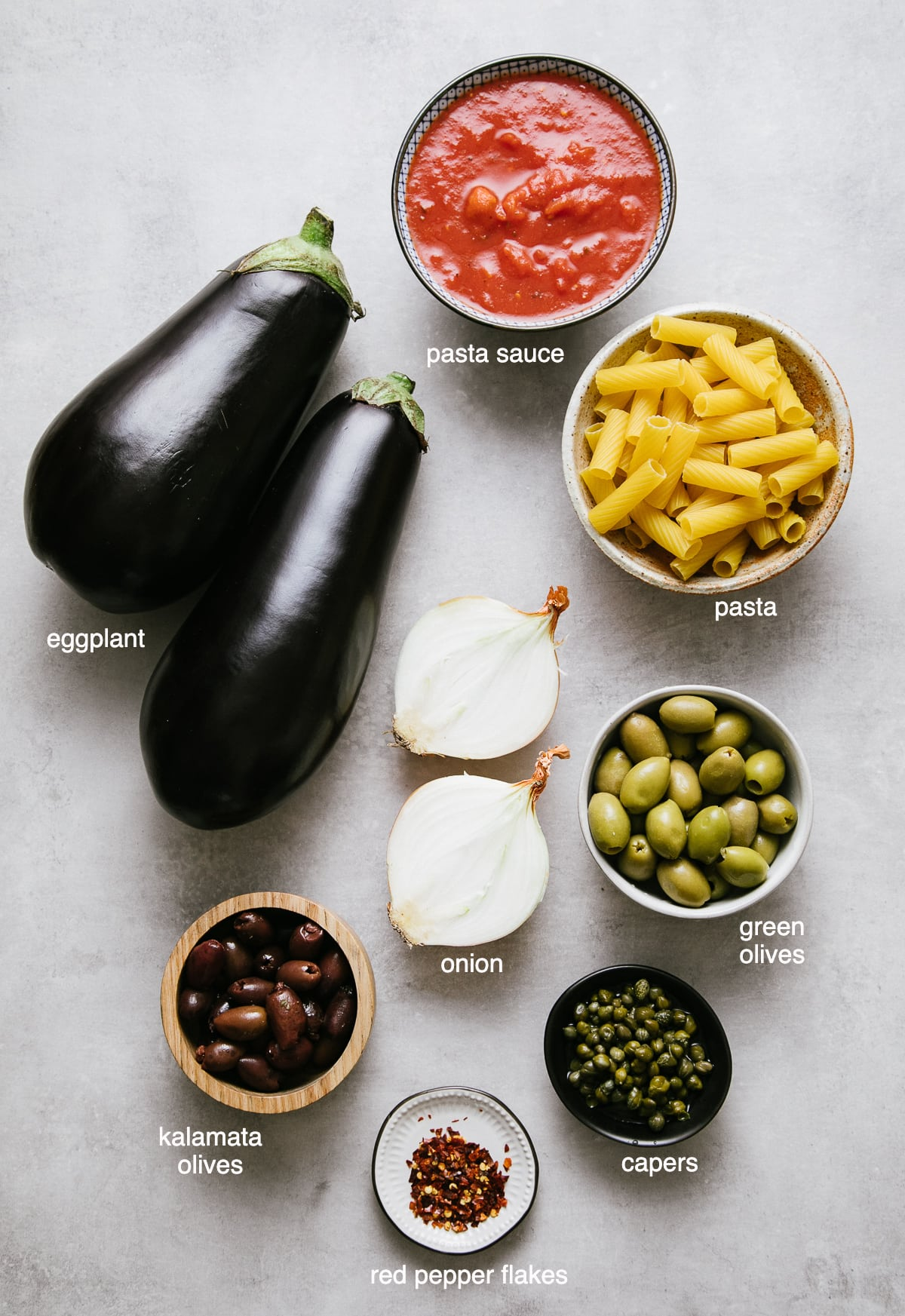 top down view of ingredients used to make eggplant puttanesca recipe.