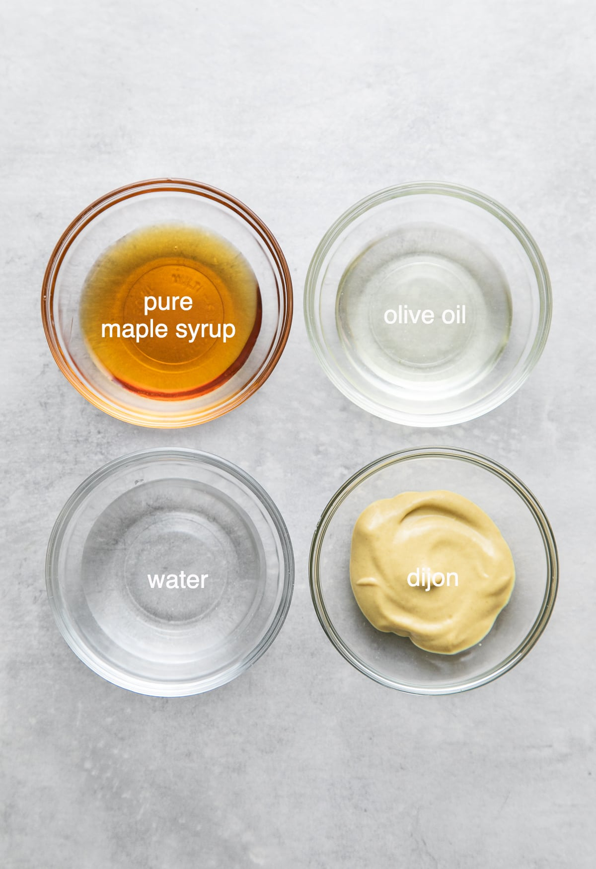 top down view of ingredients used to make not so honey, maple dijon dressing.