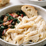 creamy white bean and cauliflower alfredo sauce with penne pasta in a bowl