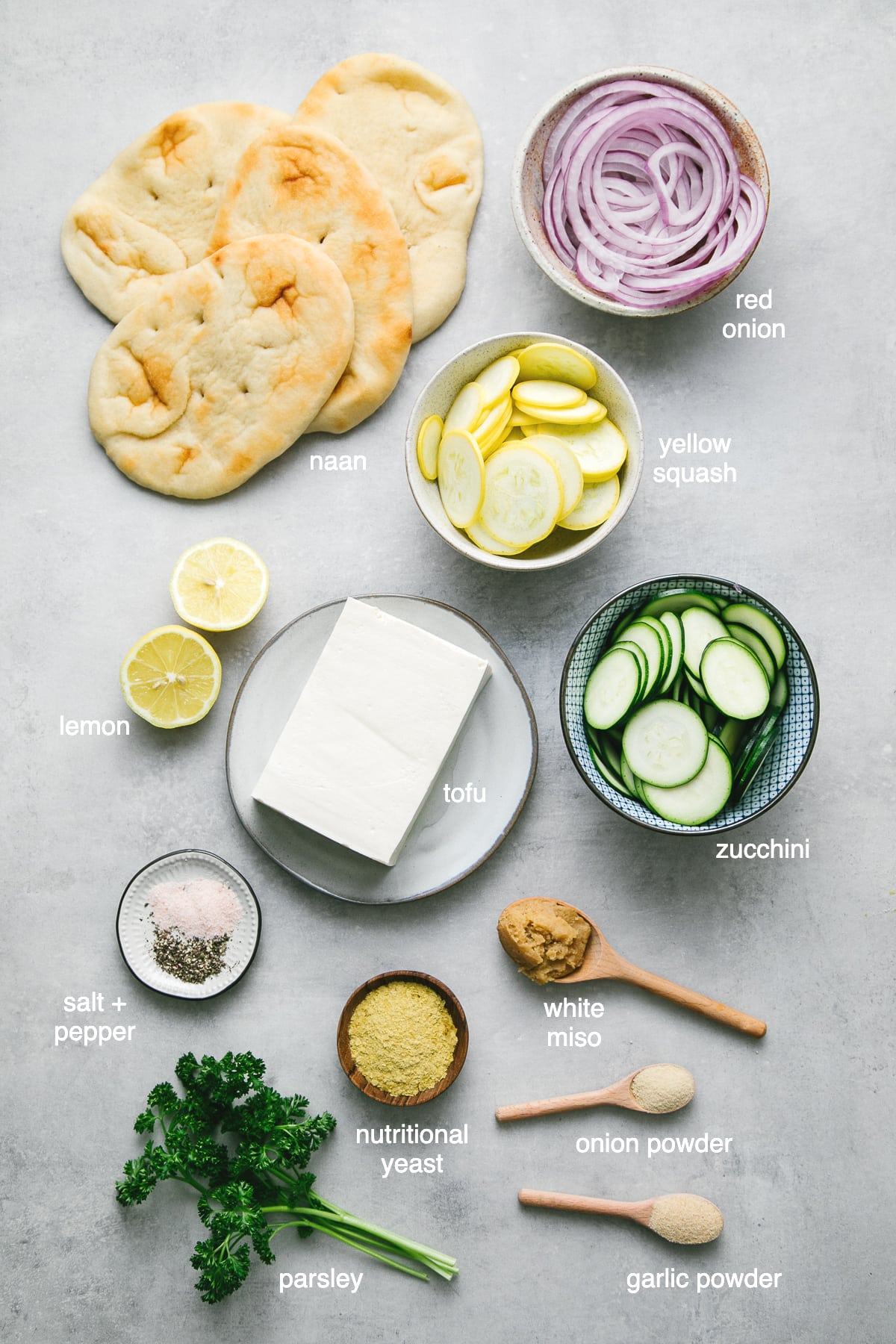 top down view of ingredients used to make vegan white pizza aka zucchini flatbread.