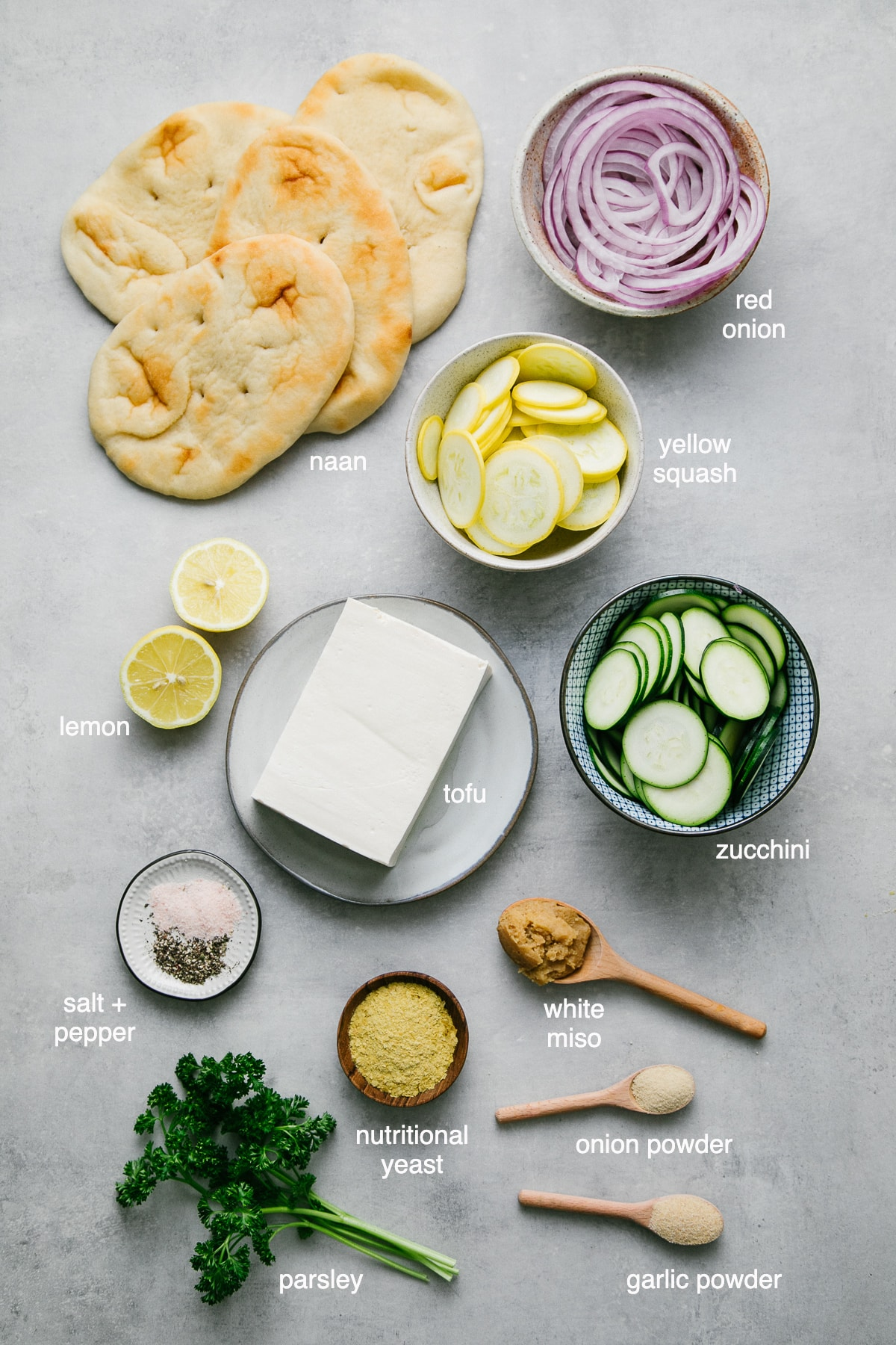 top down view of ingredients used to make zucchini flatbread vegan white pizza.