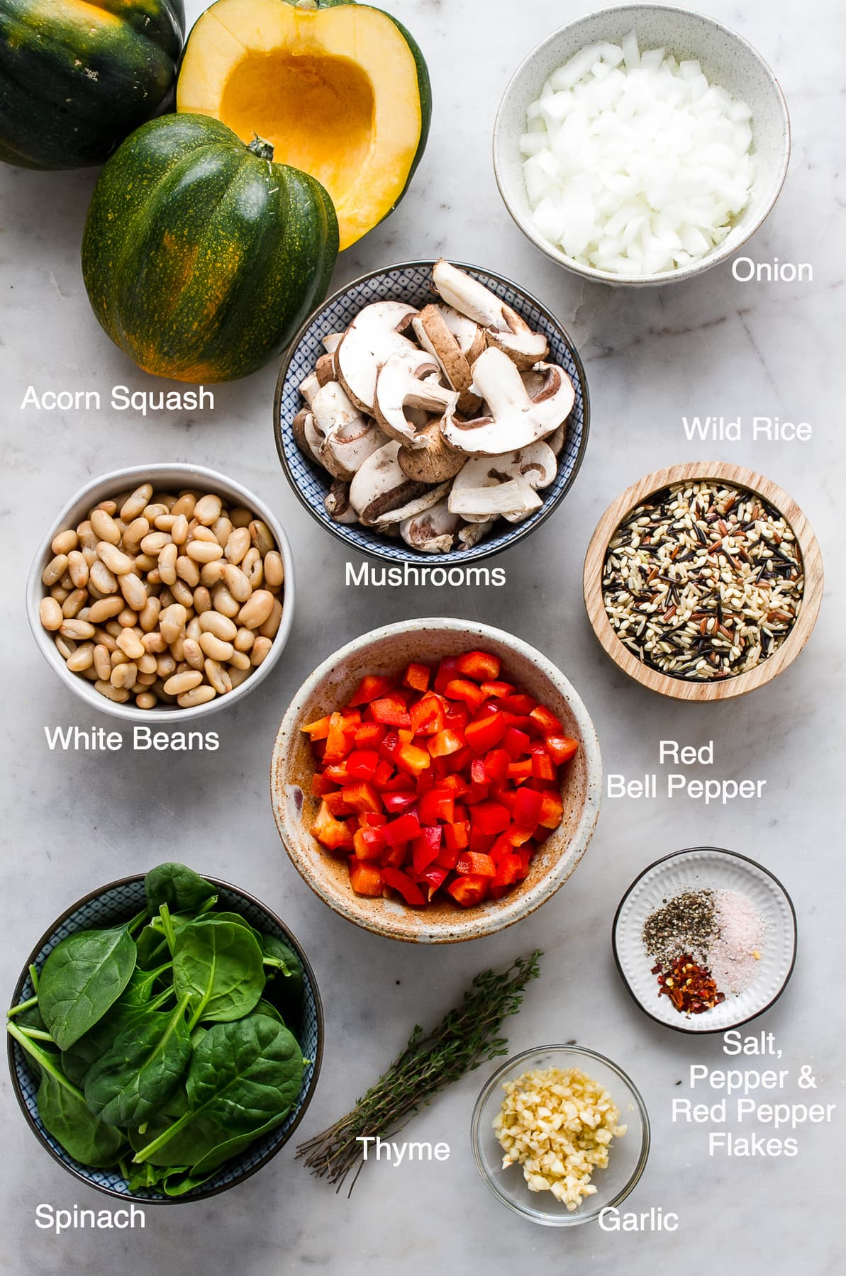 top down view of ingredients needed to make acorn squash and wild rice medley.