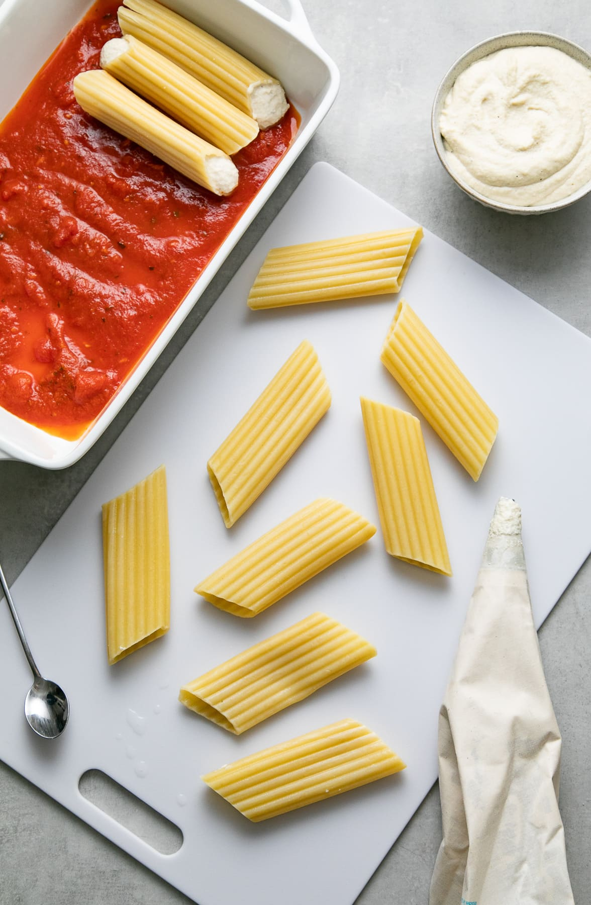top down view showing the process of making vegan manicotti recipe.