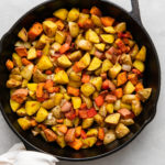 top down view of freshly made gold and sweet potatoes in a skillet.