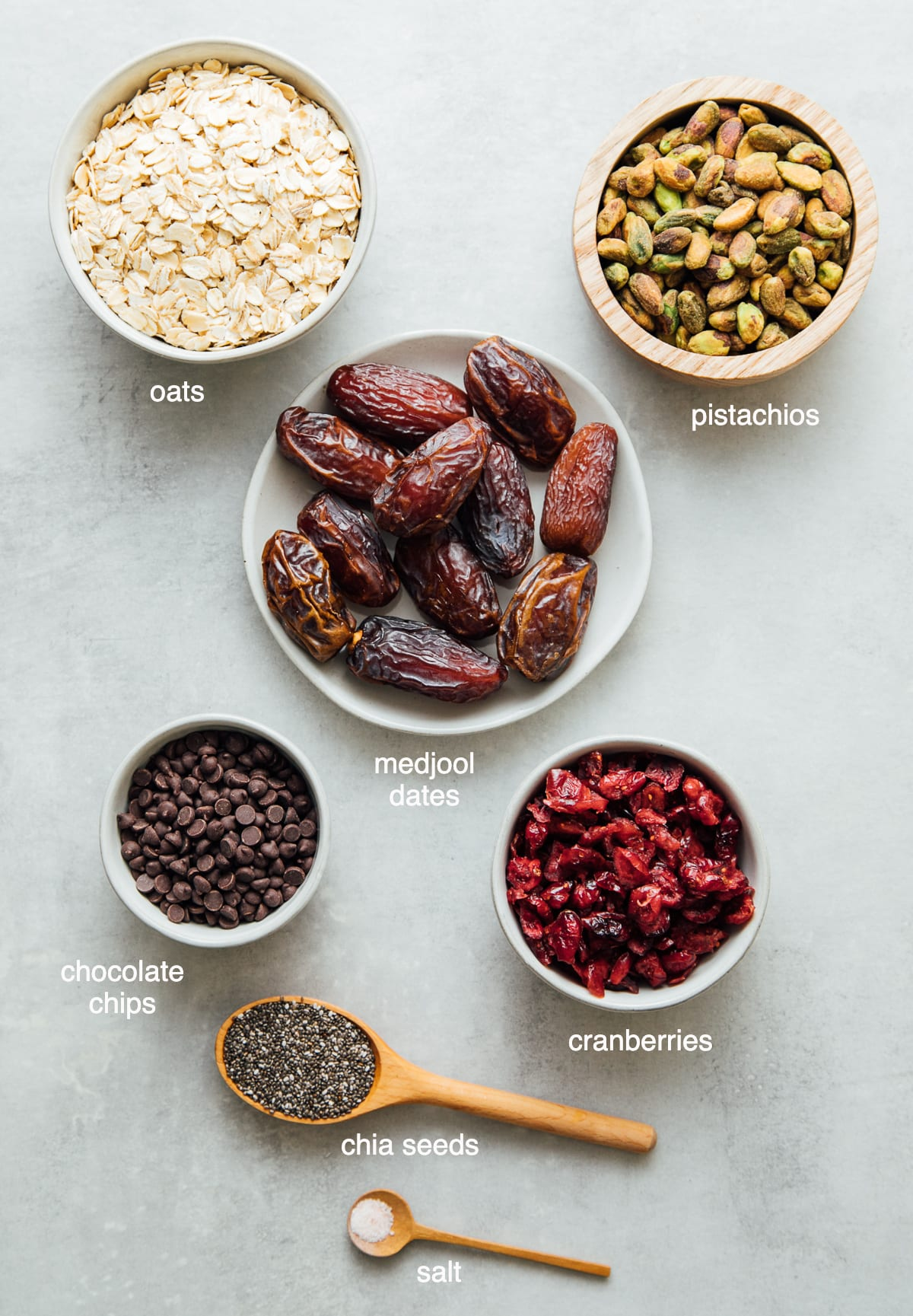 top down view of ingredients used to make oatmeal energy bites with cranberries, pistachios and dates.