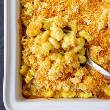 baked vegan mac and cheese with crispy top and spoon scooping to serve