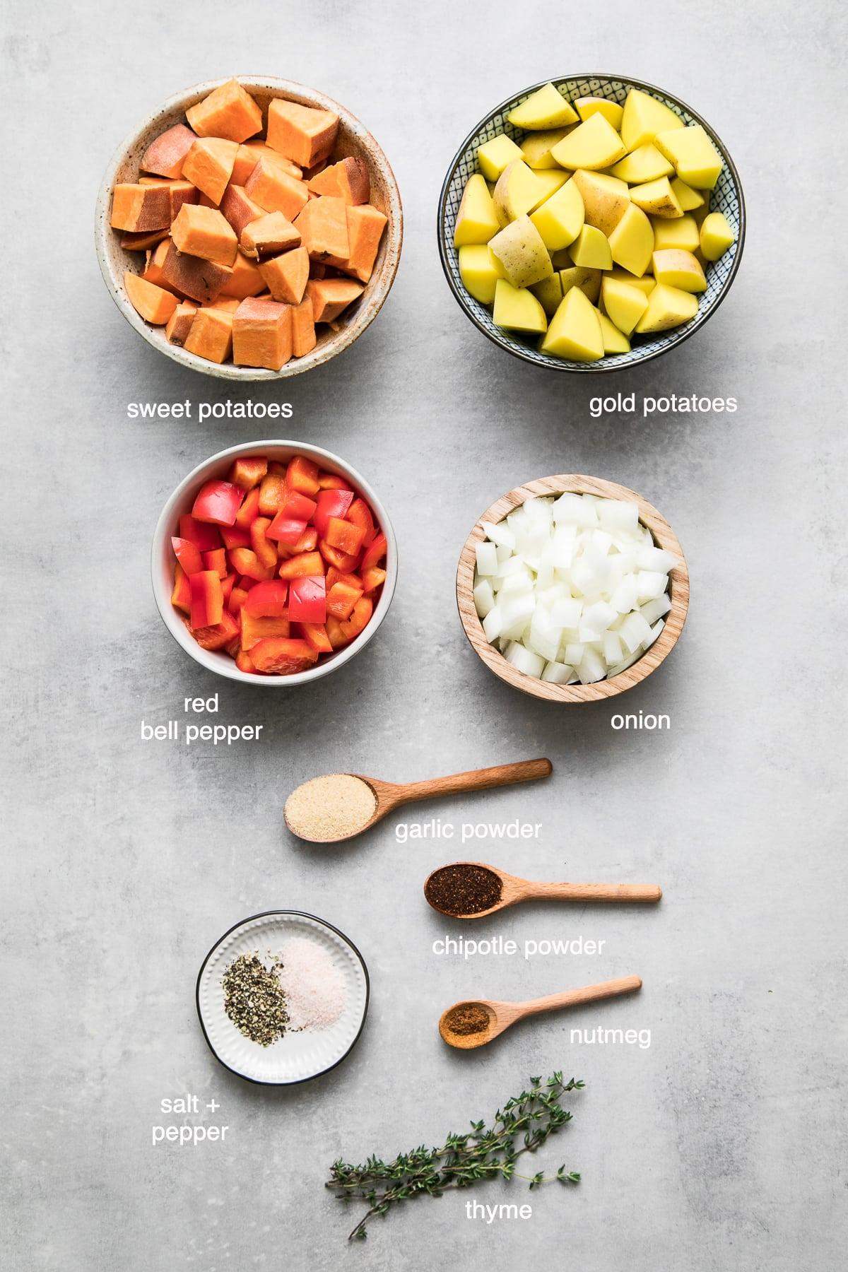 top down view of ingredients used to make yukon and sweet potato home fries.