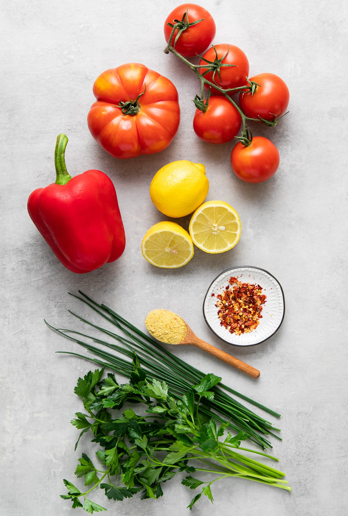 top down view of ingredients needed to make raw tomato soup recipe.