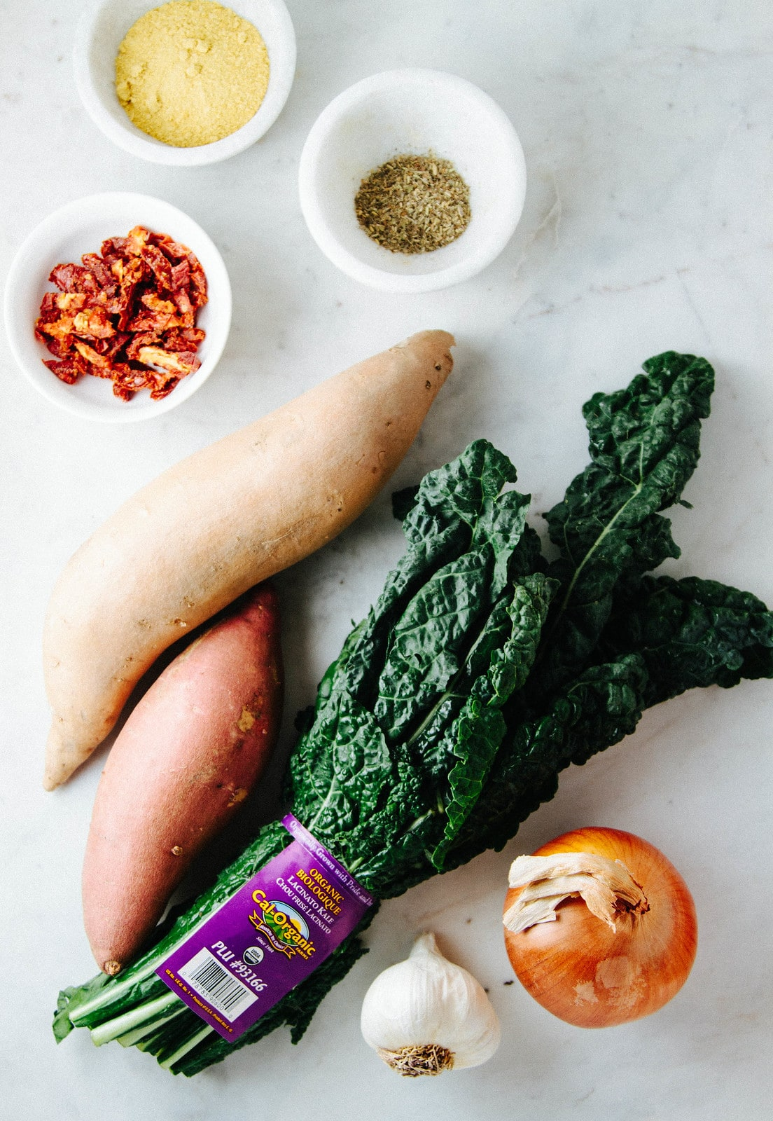 top down view of ingredients used to make sweet potato and kale soup.