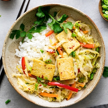 top down view cabbage stir fry with tofu in a bowl.