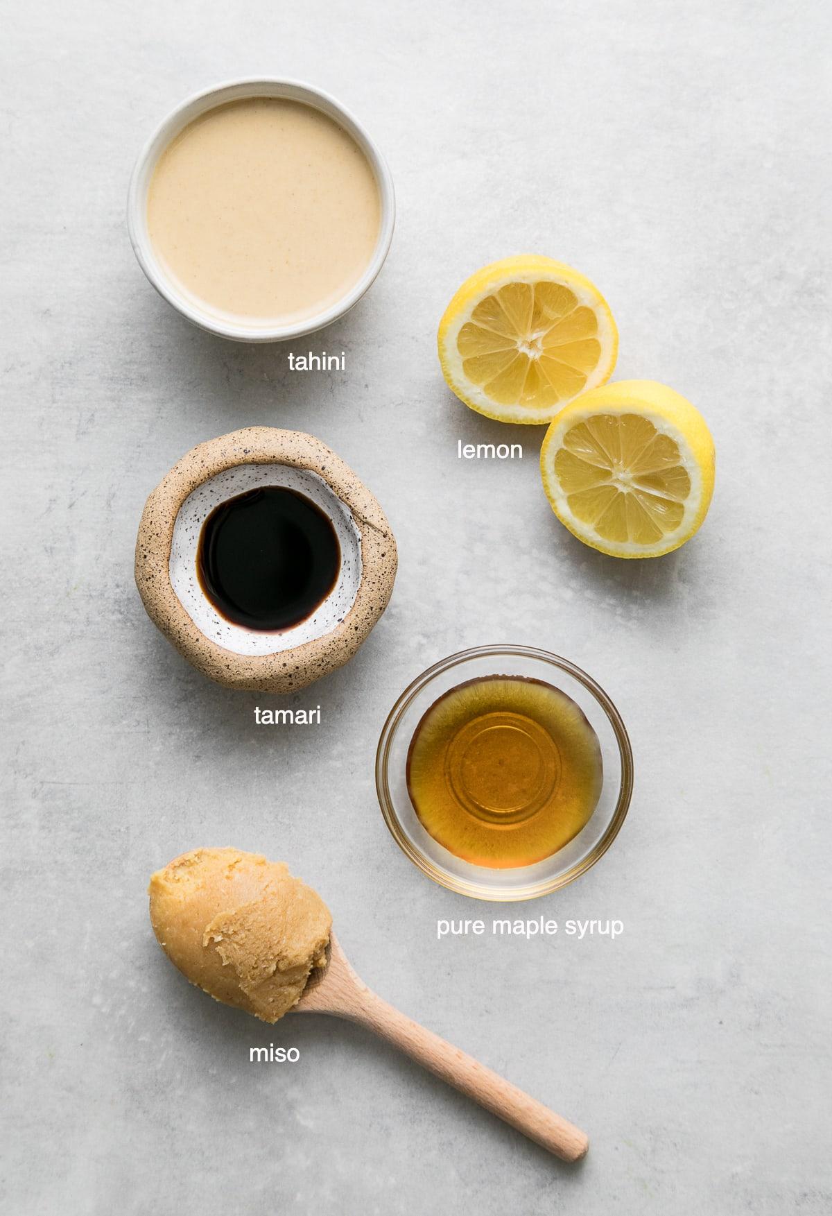 top down view of ingredients used to make creamy tahini miso dressing-dip recipe.
