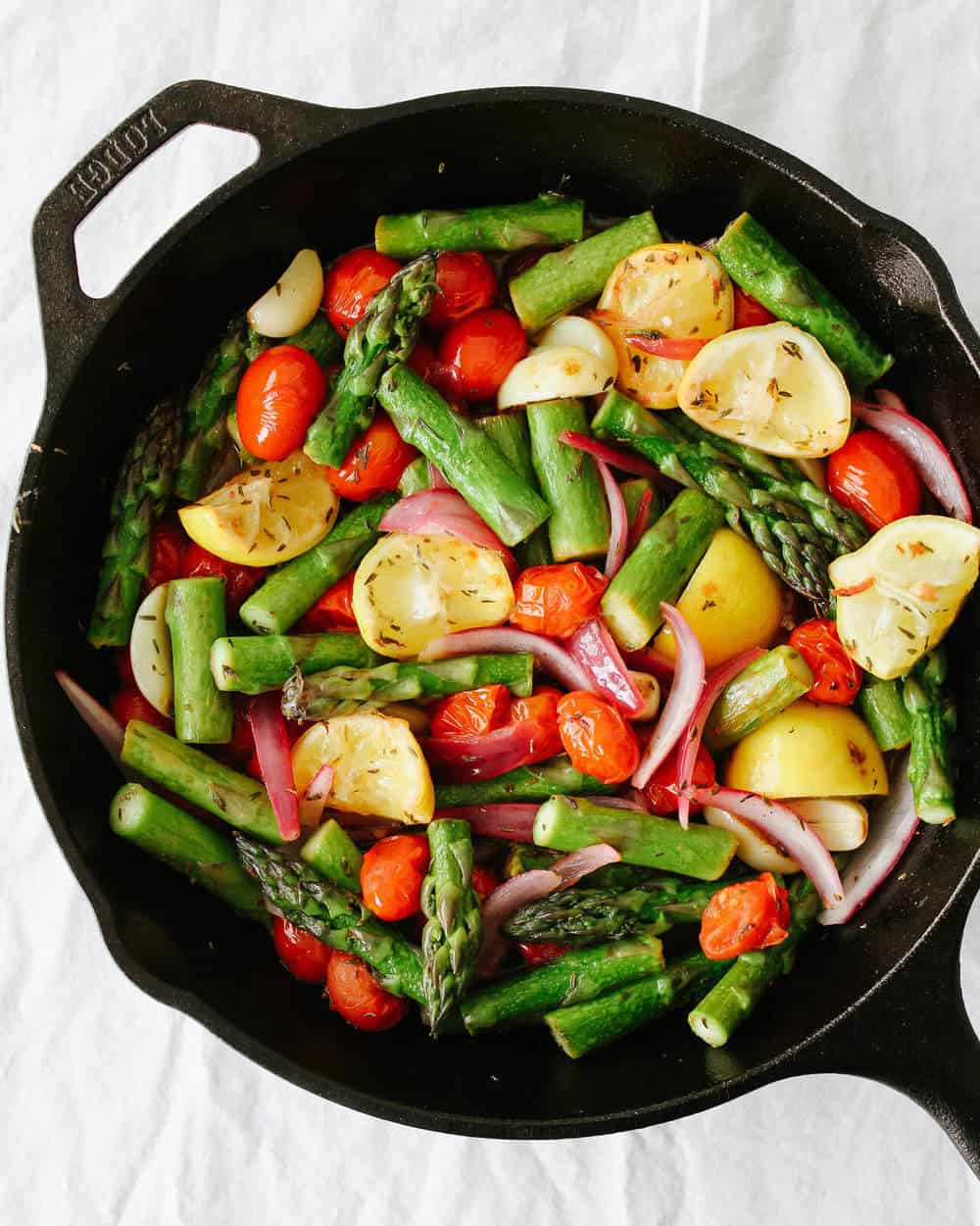 skillet asparagus and tomato medley in a cast iron pan