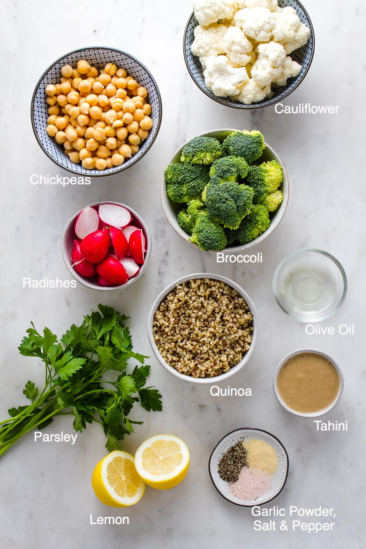 top down view of ingredients needed to make roasted vegan buddha bowl.
