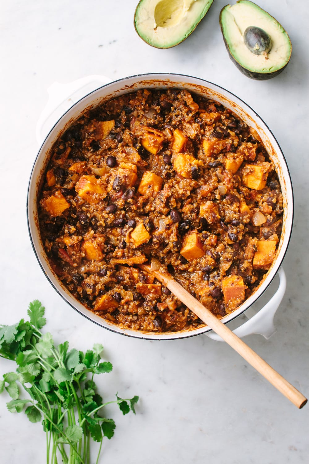 top down view of a pot full of freshly made sweet potato and quinoa chili.