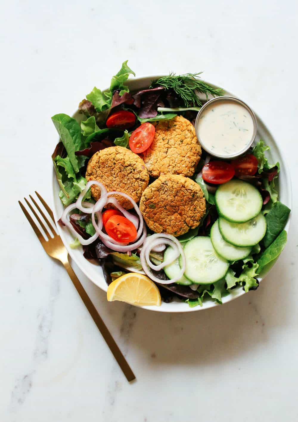healthy baked falafel salad with creamy tahini dressing