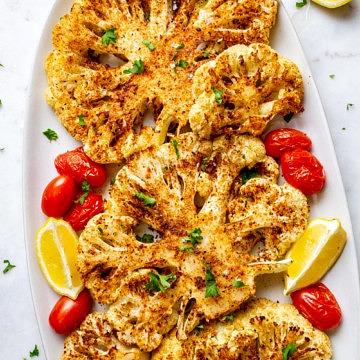 blackened cauliflower steaks on a platter