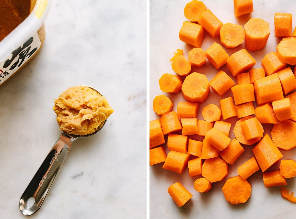 side by side picture of a tablespoon of miso, next to sliced carrots.