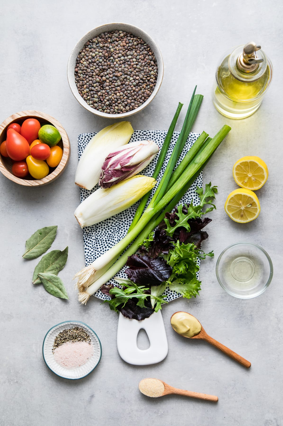 top down view of ingredients used to make french lentil and bitter greens salad.