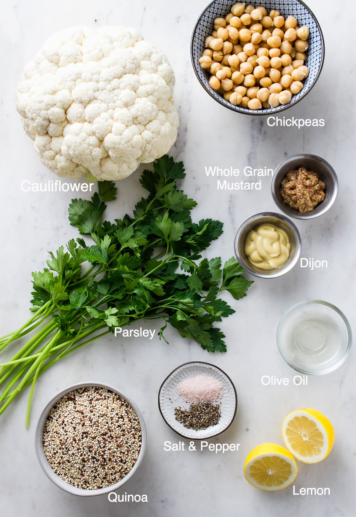 top down view of the ingredients used to make roasted cauliflower recipe with mustard dressing, chickpeas and quinoa.