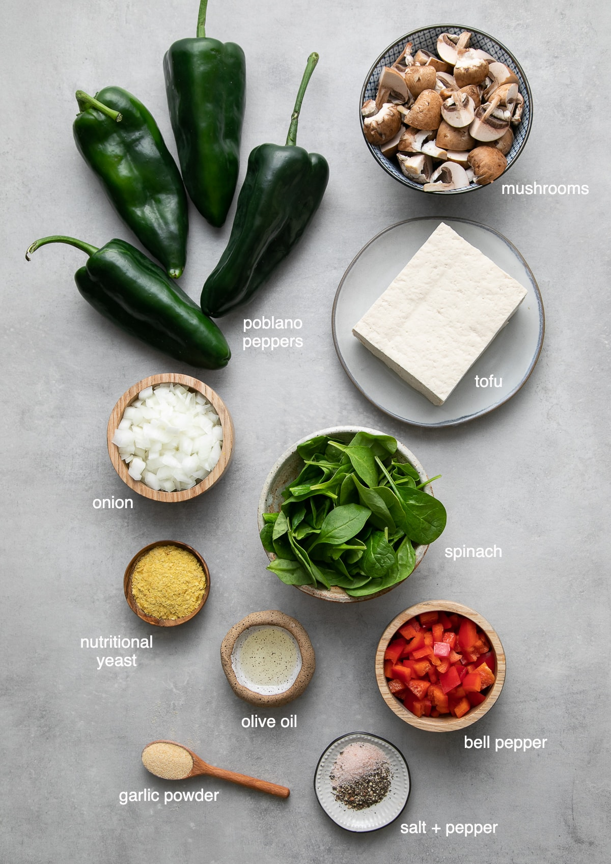 top down view of ingredients used to make tofu scramble stuffed pobano peppers.
