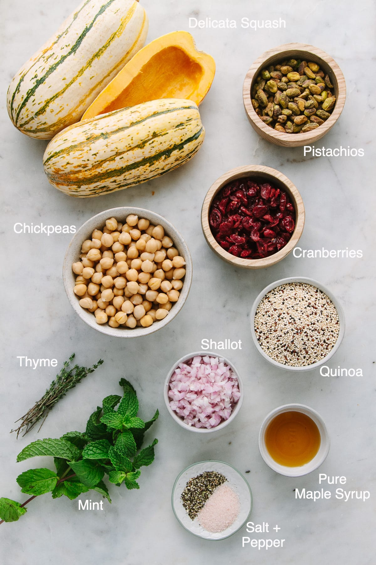 top down view of ingredients used to make stuffed delicata squash with quinoa, chickpeas, cranberries and pistachios.