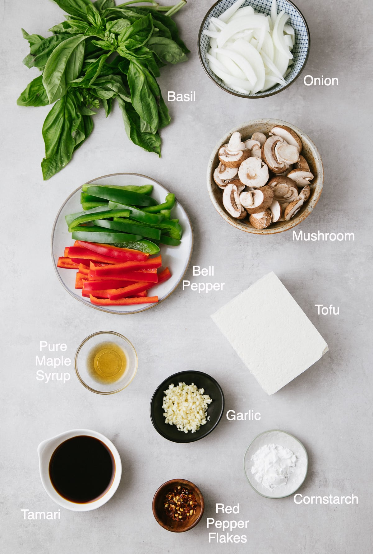 top down view of ingredients used to make basil stir fry with tofu and veggies.