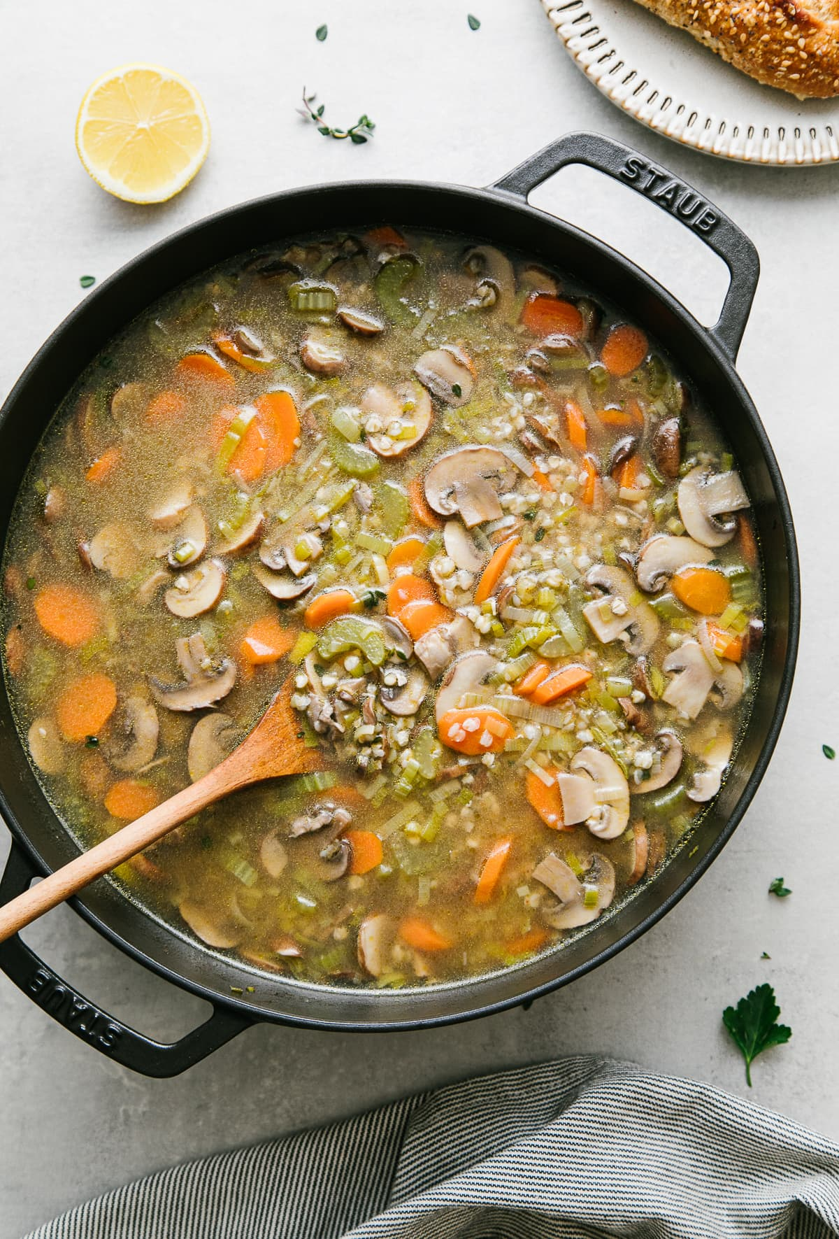 top down view freshly made pot of mushroom buckwheat soup with items surrounding.