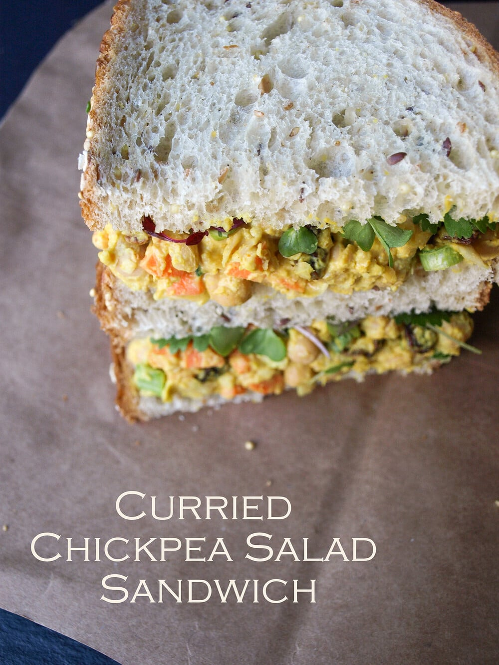 top down side angle view of curried chickpea chicken salad sandwich.