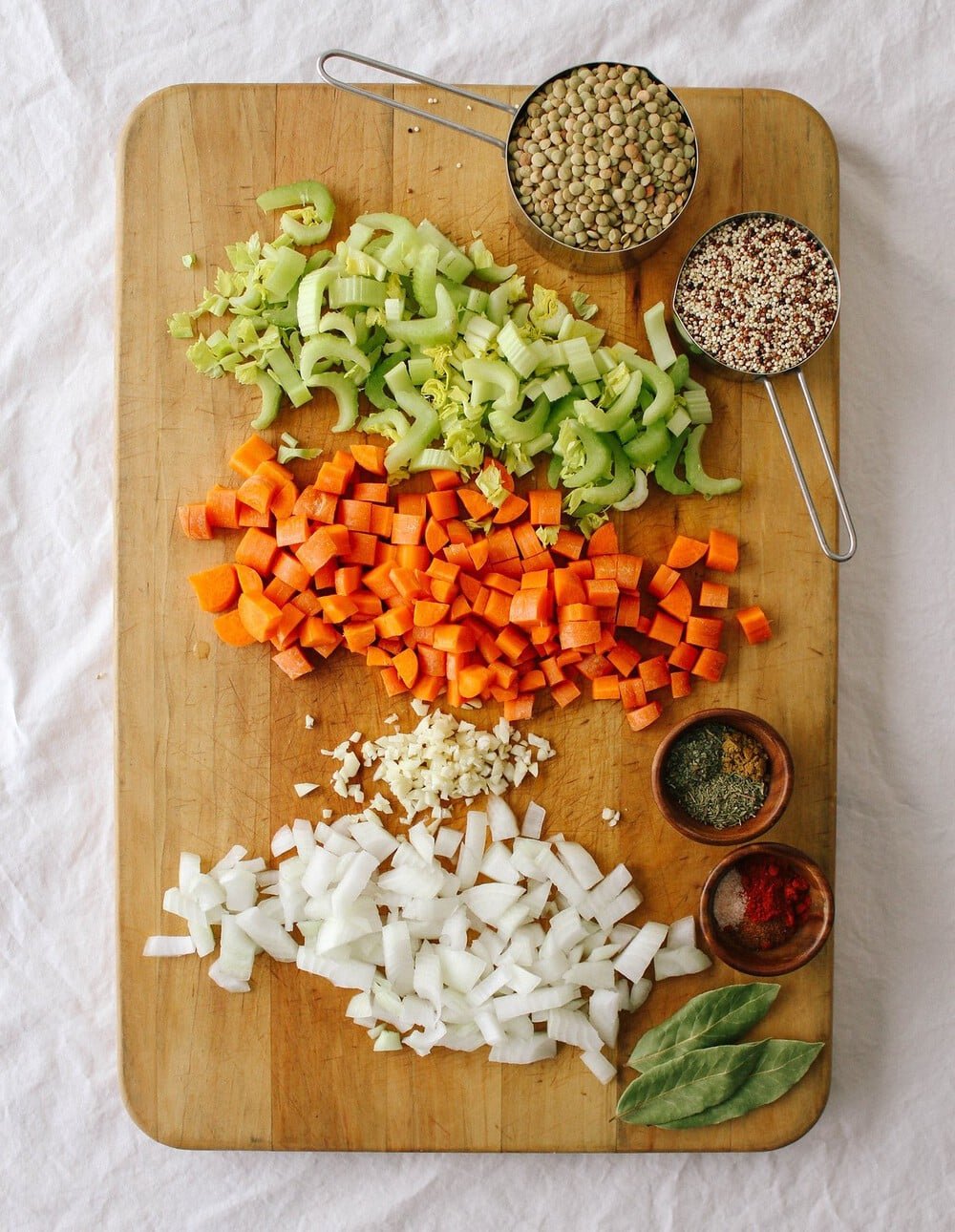 top down view of ingredients to make smoky lentil soup on a cutting board.