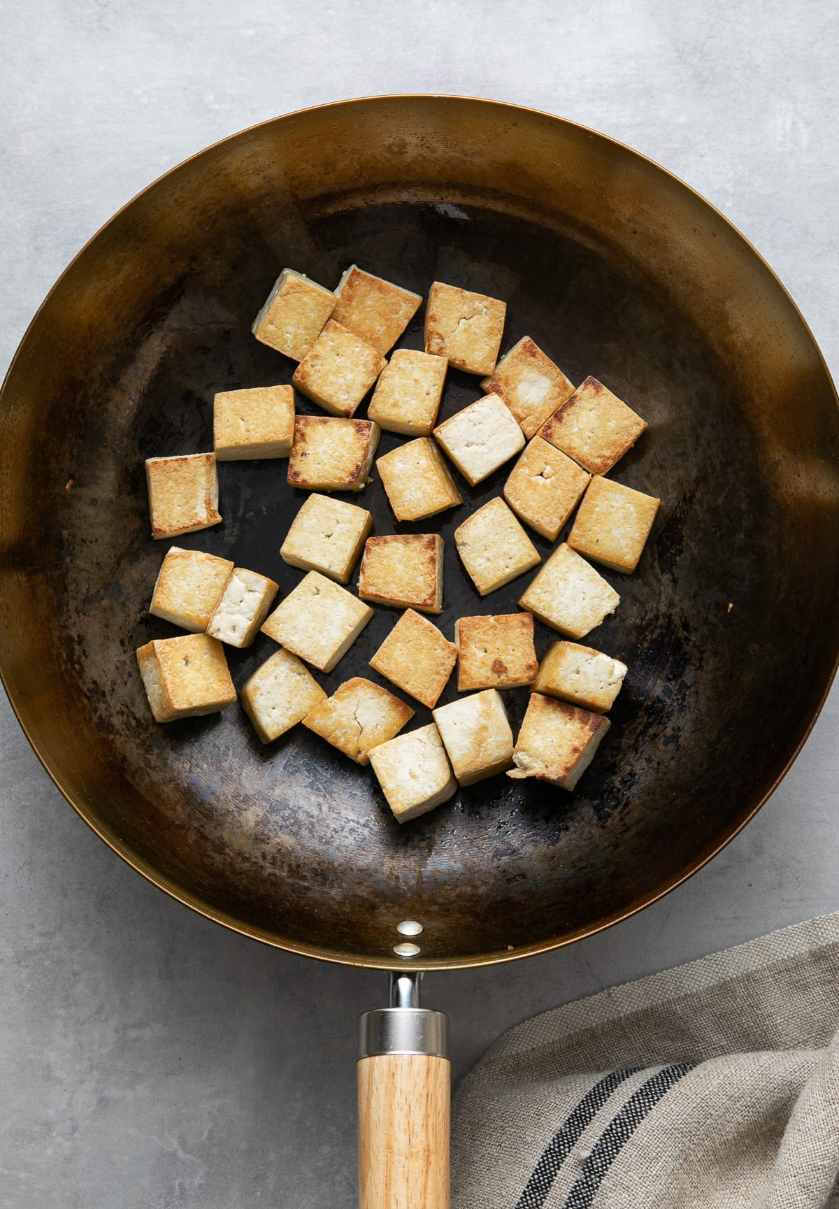 top down view of crispy tofu in a wok.