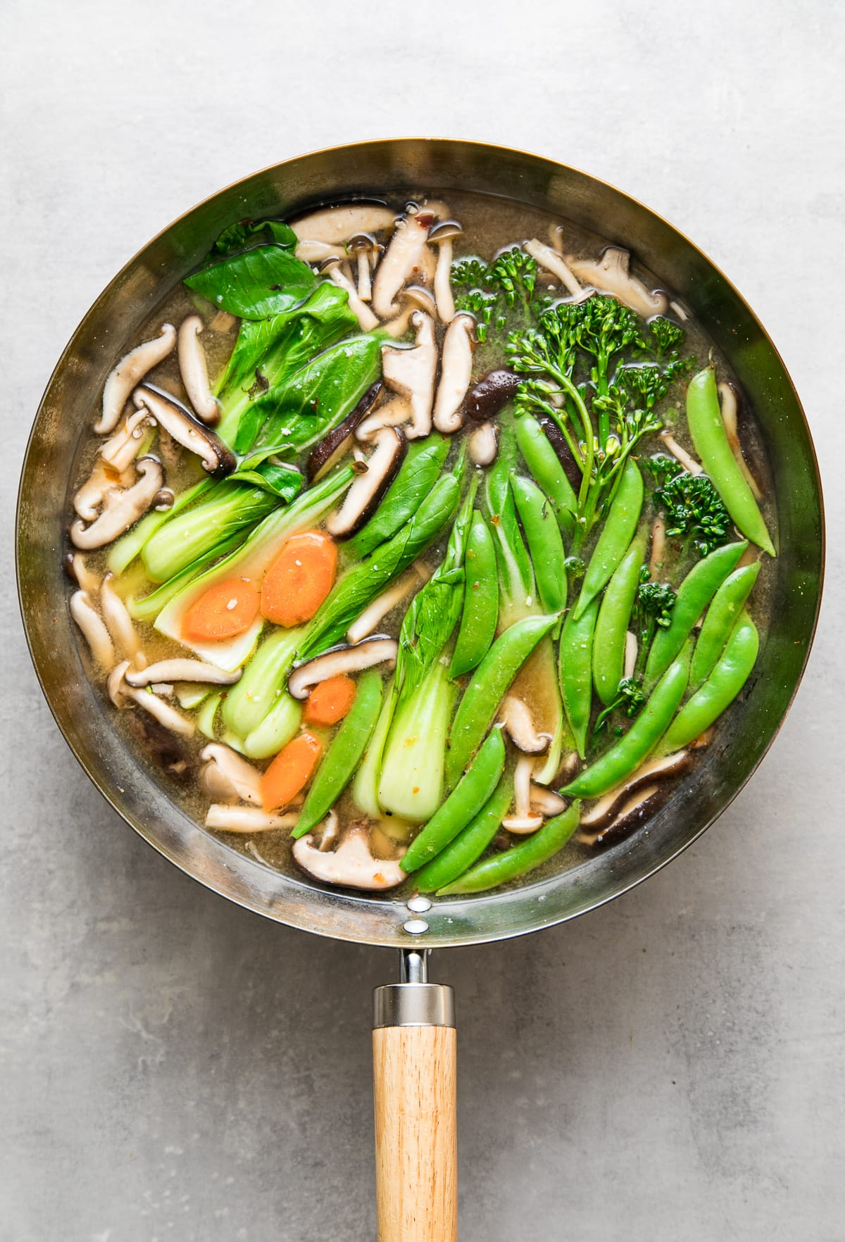top down view of a wok with freshly made vegetable miso soup.