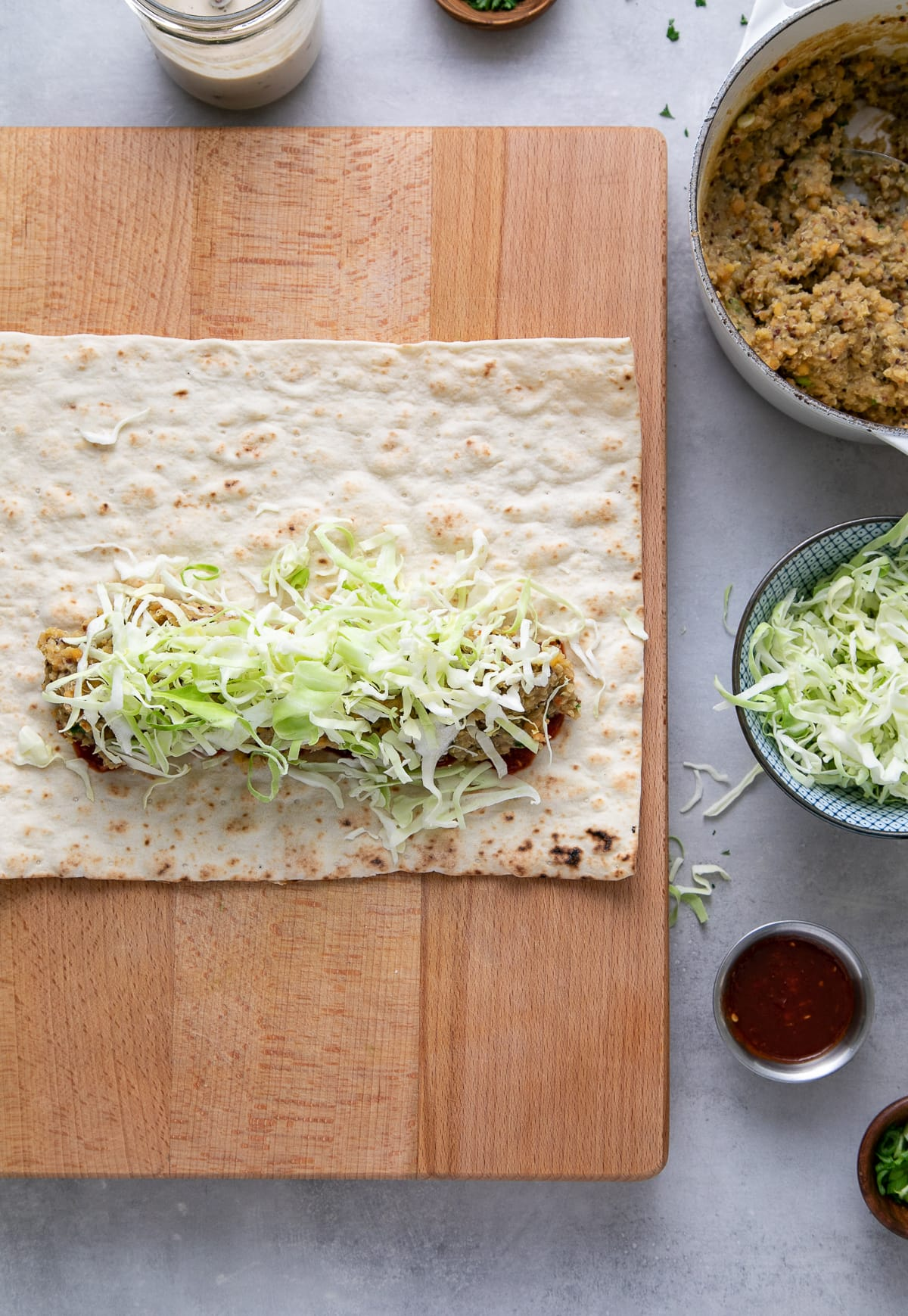 top down view showing the process of making spicy quinoa lentil wraps.