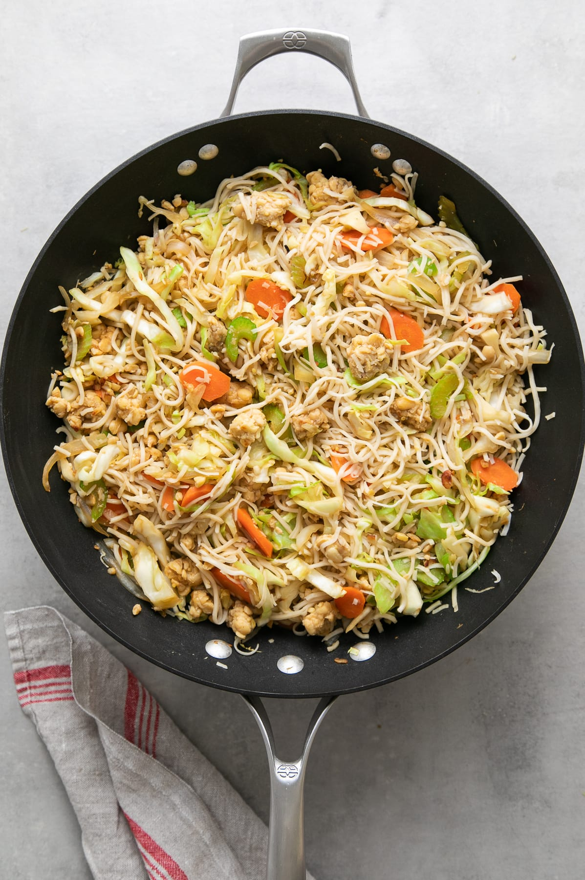 top down view of freshly made batch of tempeh chow mein in wok.
