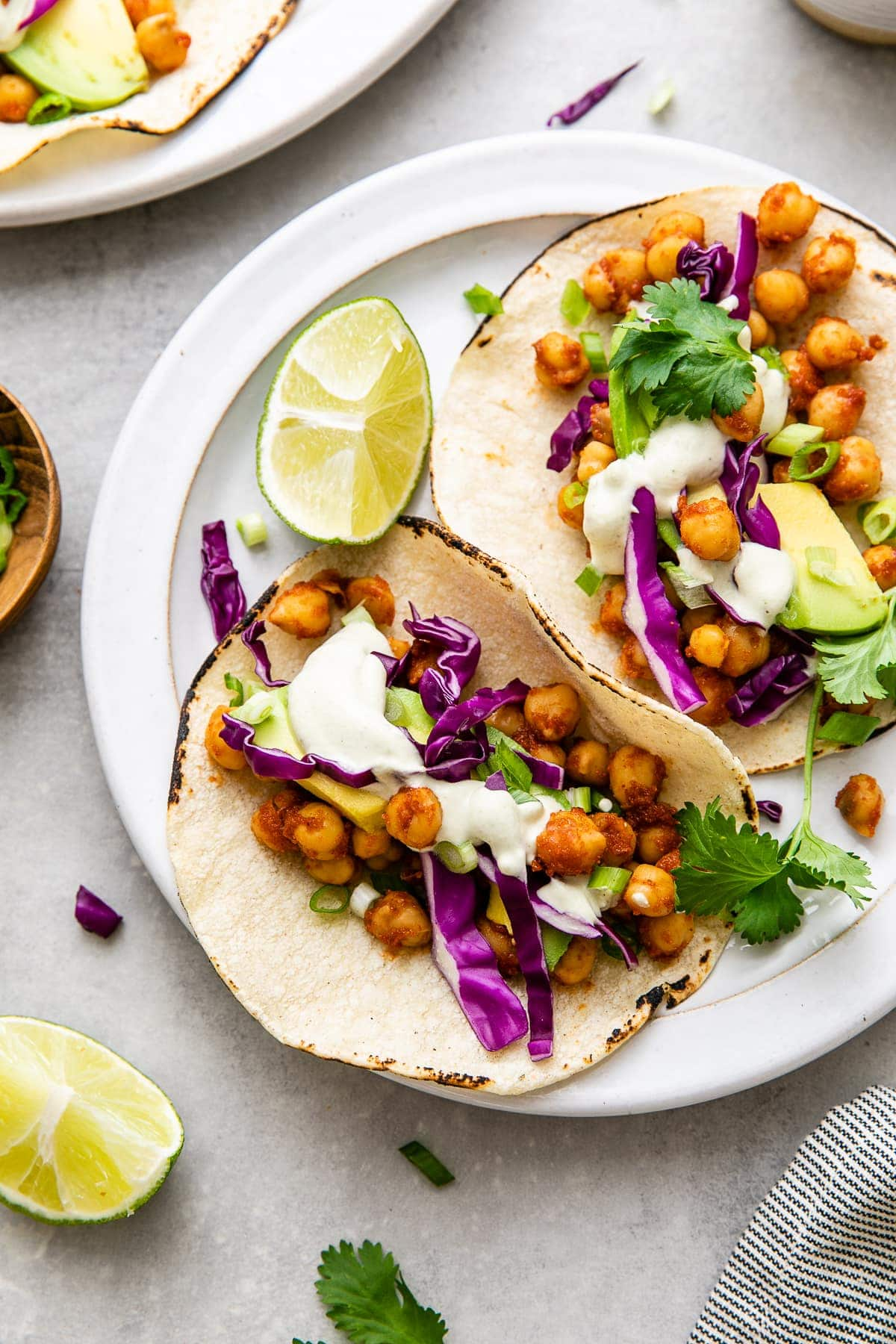 top down view of plate with chickpea tacos and items surrounding.