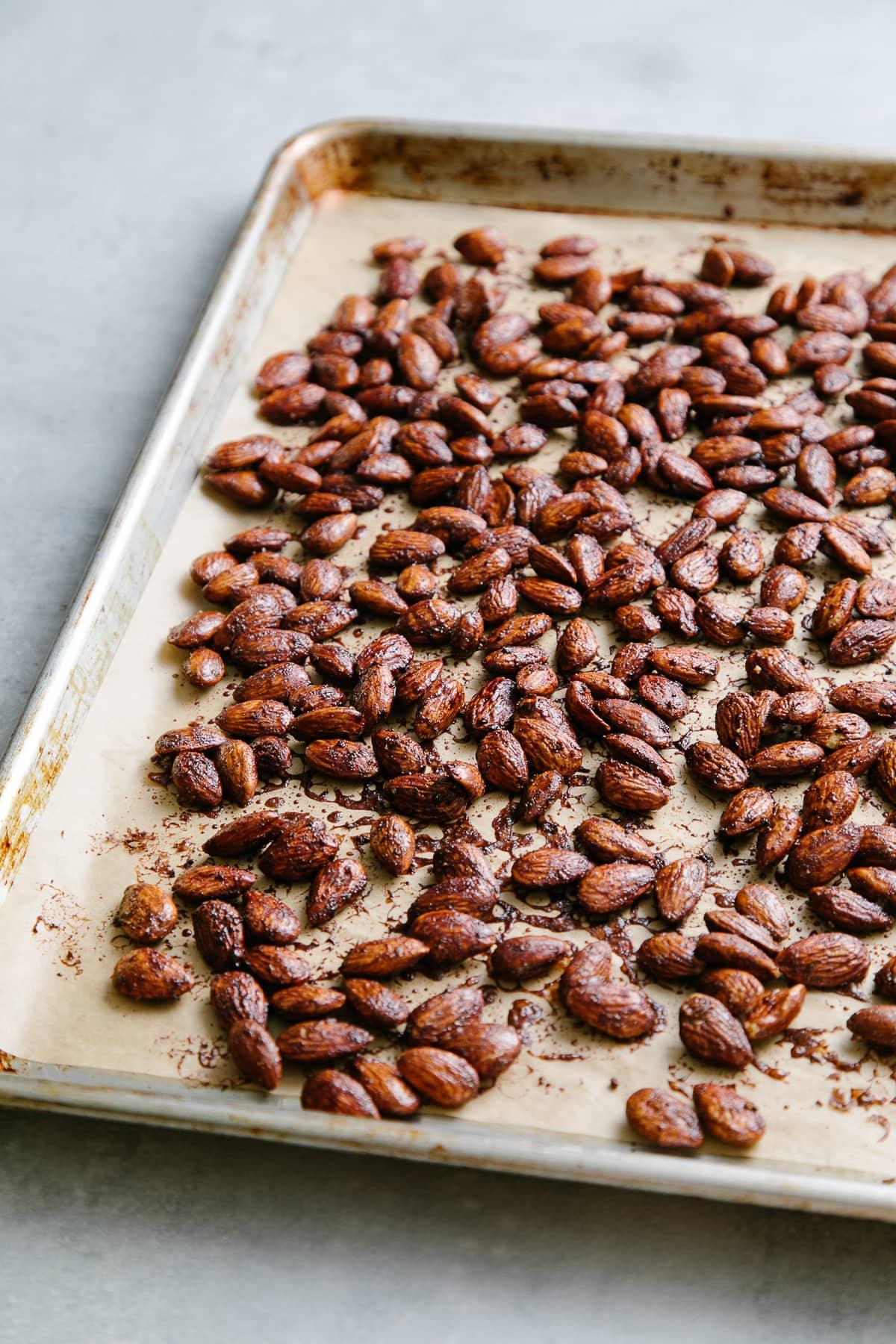 side angle view of freshly roasted almonds with chocolate chai glaze.